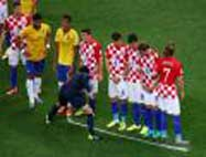 Soccer referee vanishing foam spray can to mark free kick spot and player wall.